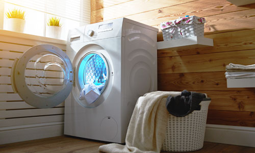 A modern dryer in laundry room